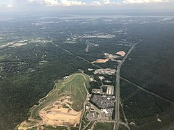 2019-07-22 15 54 55 View south along Virginia State Route 234 (Dumfries Road) toward the Potomac River from an airplane heading for Washington Dulles International Airport passing over Independent Hill, Prince William County, Virginia.jpg