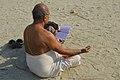 2019 Jan 15 - Kumbh Mela - Devotee Reading Holy Booklet at Prayagraj Kumbh Mela.jpg