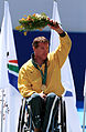 241000 - Athletics wheelchair racing 5km T52 Greg Smith gold medal podium - 3b - 2000 Sydney medal photo.jpg