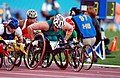 261000 - Athletics wheelchair racing 1500m Louise Sauvage gold action - 3b - 2000 Sydney race photo.jpg