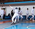 2nd Leonidas Pirgos Fencing Tournament. The fencer Lampros Dimitropoulos performs a flèche and is about to score a touch.jpg