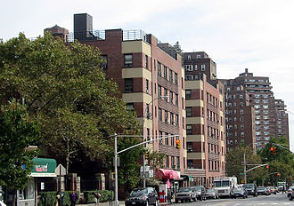Cooperative Village - View of Grand Street showing 26 years of cooperative development: Amalgamated Dwellings (1930) in the foreground with two of the Hillman Housing buildings (1947-50) behind it. One of the East River Housing towers (1953-56) in the background.