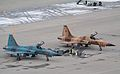 761585 AF-13 an F-5N of VFC-13 ex Swiss AF J-3060 in the Desert scheme and 761559 AF-24 ex Swiss J-3034 in the Blue gray (3356954916).jpg
