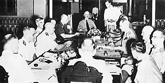 American-British-Dutch-Australian Command - The first ABDACOM conference. Seated around the table, from left: Admirals Layton, Helfrich, and Hart, General ter Poorten, Colonel Kengen (at head of table), and Generals Wavell, Brett, and Brereton