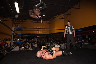 ACH (wrestler) - ACH executing a 450° splash onto Michael Elgin