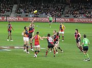 AFL match between Essendon (red and black) and Adelaide
