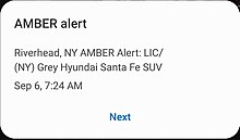 "An amber alert on Android. An amber alert on Android. Text reads in all caps ""Riverhead, NY AMBER Alert: LIC/ [license plate removed] (NY) Grey Hyundai Santa Fe SUV""."