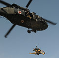 A flight medic with Charlie Company, 2nd Battalion, 3rd Aviation Regiment, is hoisted into a medical helicopter with Luca, a Military Working Dog with 4th Stryker Brigade Combat Team, 2nd Infantry Division 110224-A-XA218-0025.jpg