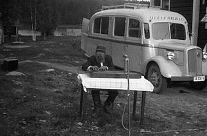 Kantele - A man plays a kantele with his fingers in 1930s Finland