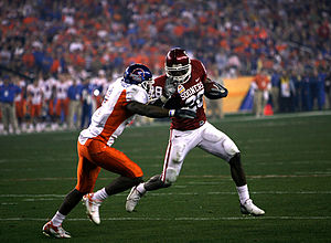 2006 Oklahoma Sooners football team - Oklahoma's Adrian Peterson breaks a tackle of Boise State's Gerald Alexander.