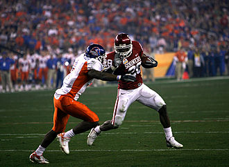 Adrian Peterson - Peterson runs against Boise State in the 2007 Fiesta Bowl.