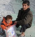 Afghan boys hold a bag of school supplies given to them by members of the Regional Command-East Female Engagement Team during Operation School Supplies Nov. 10, 2011, at Bagram Airfield, Afghanistan 111110-A-DY116-006.jpg