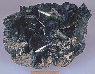 Allanite - Allanite from the Mt. Isa – Cloncurry area, Queensland, Australia (scale bar 1 inch)