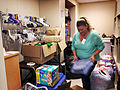 Andrea Collins sorts and folds donations in the Airman's Attic at Tinker Air Force Base, Okla., May 21, 2013 130521-F-BN045-001.jpg