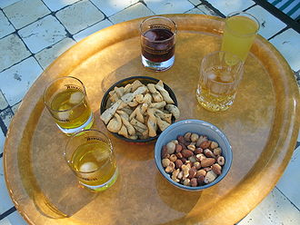 Apéritif and digestif - Five glasses of apéritif and mixed nuts