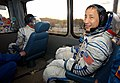 Astronaut Edward T. Lu (foreground) and cosmonaut Yuri I. Malenchenko ride in a bus to the launch pad.jpg