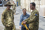Australian soldiers and U.S. Sailors participating in Pacific Partnership 2013 exchange gifts on the amphibious dock landing ship USS Pearl Harbor (LSD 52) in Honiara, Solomon Islands, July 29, 2013 130729-N-SP369-170.jpg