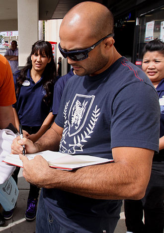 "B.J. Penn - Penn autographing a copy of his autobiography, ""Why I Fight"""