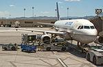 Baggage loading into airplane.jpg