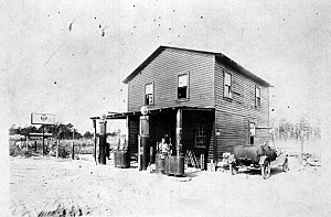 Baldwin, Florida - A country store with gas pumps in 1926.