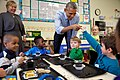 Barack Obama and a young student touch fingers, 2015.jpg