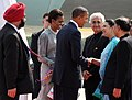 Barack Obama and the First Lady Mrs. Michelle Obama being welcomed by the Indian Ambassador to US, Mrs. Meera Shankar, on their arrival, at Chhatrapati Shivaji International Airport, in Mumbai, on November 06, 2010.jpg