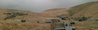 Bedouin encampment in the Negev Desert Bedouin squatter compound.png