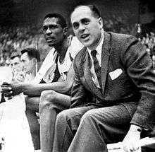 Auerbach and Russell seated on the sidelines