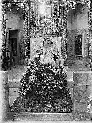 Post-mortem photography - Syrian bishop seated in state at his funeral (ca. 1945).
