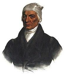 Dipinto di Zoccolo Nero in abiti in stile americano ma con indosso un turbante Shawnee