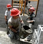 Bond beam work at Gabriela Mistral School construction site 150622-F-LP903-420.jpg