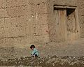 Boy by house, Afghanistan.jpg