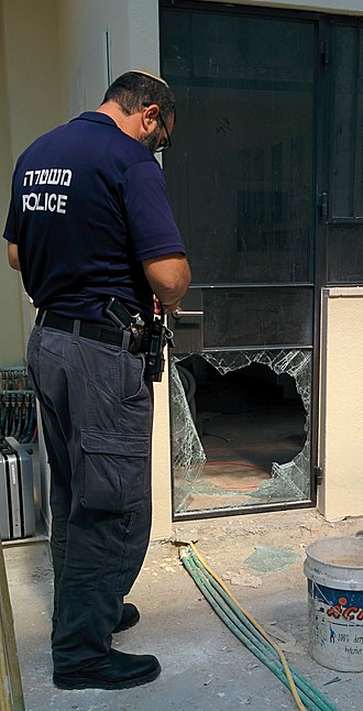 Burglary - An Israeli forensic policeman inspects a burglary scene