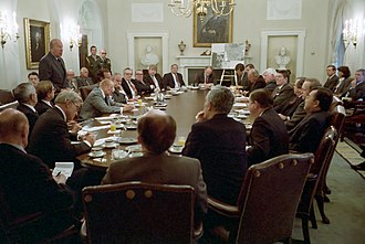 Reagan and Bush in a meeting to discuss the United States' invasion of Grenada with a group of bipartisan members of Congress in October 1983 C17903-4.jpg