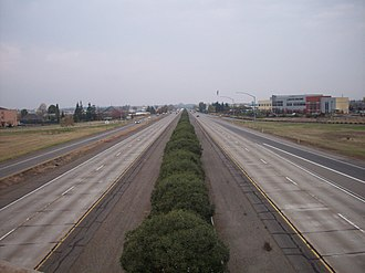 California State Route 99 - Facing north from Skyway on State Route 99 in Chico. The  Butte College, Chico Campus is visible on the right.