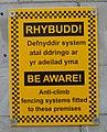 Caernarfon anticlimb fencing sign.jpg
