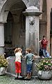 Cannobio - fountain with kids and young woman.jpg
