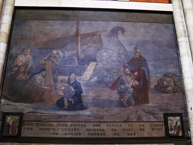 """Fresco about Saint-Nicholas in the Saint-Nicolas church in Capbreton (Landes, France). The text is: """"Saint-Nicholas, in order to save people from hunger, made miracoulosly appeared in the port of Myrne a ship carrying wheat."""