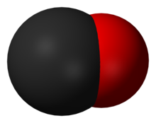 A large black spherical object with a slightly smaller red one merging into it from the right