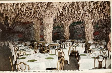 """The Cave"" in the basement of the Gruenwald (later Roosevelt) Hotel, New Orleans opened in 1912; said by some to be one of the first nightclubs in the United States CardGrunewaldCave.jpg"