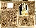 Carved stucco wall panel surrounding a window, from Samarra, Iraq, 3rd century CE. Iraq Museum.jpg