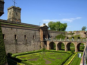 Montjuïc Castle - Entrance to Montjuïc Castle across the former moat, now dry and planted as a parterre