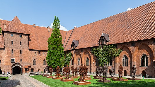 Array of iron warriors in the courtyard of the Malbork Castle, Malbork, Poland