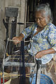 Central Java Community Assistance Program, weaving business,Mrs Wagiyem spinning yarn. Indonesia, 2008. Photo- Lorrie Graham (10679169255).jpg