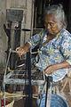 Central Java Community Assistance Program, weaving business,Mrs Wagiyem spinning yarn. Indonesia, 2008. Photo- Lorrie Graham (10679169255).jpg