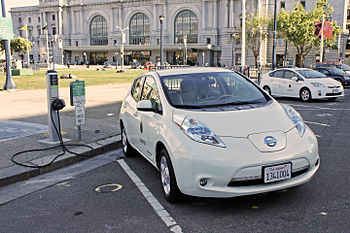 Nissan Leaf at a public charging station in front of San Francisco City Hall