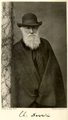 Charles-Darwin-portrait-standing-photo-1881.png