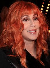 A picture of a red-headed woman, Cher.