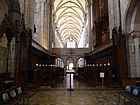 Chichester Cathedral's nave from the high altar (looking west).JPG