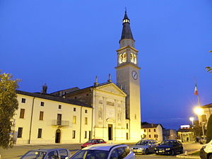 Roverchiara - Victory Emanuel II square with Saint Zeno church in the evening